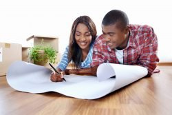 Couple looking over house plans in DC