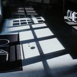 Picture of The ONE Street Company Office with light reflections on logo